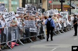 "FILE - Supporters line seventh avenue during the ""Stop Iran"" protest near Times Square in New York, July 22, 2015."