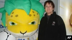 New Zealand fan Pam Sceats poses with the South African World Cup mascot, Zakumi