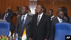 Ivory Coast President Alassane Quattara (r) is Chairman of ECOWAS Authority of Heads of State and Government.