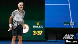 Tennis - Australian Open - Melbourne Park, Melbourne, Australia - 29/1/17 Switzerland's Roger Federer celebrates after winning his Men's singles final match against Spain's Rafael Nadal.