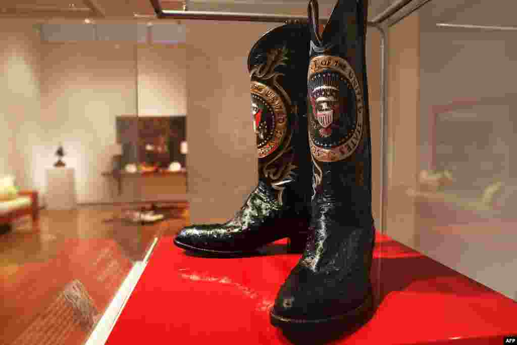 A pair of Ronald Reagan's cowboy boots sit in a case at Christie's where items from the former U.S. president and Nancy Reagan's California home are to be auctioned in New York City. Proceeds from the auction will be donated to the Ronald Reagan Presidential Foundation and Institute.