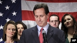 Surrounded by members of his family Republican presidential candidate, former Pennsylvania Sen. Rick Santorum announces he is suspending his candidacy effective today in Gettysburg, Pennsylvania, April 10, 2012.