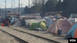 Besides staging sit-ins on the tracks, refugees set up tents to prevent trains from moving, in Idomeni, Greece, March 30, 2016. With no money or any political influence, refugees say it's the only leverage they have. (H. Murdock/VOA)