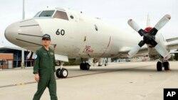 4일 호주 남서부 퍼스 공군기지에서 일본 항공자위대 소속 P-3C 초계기가 말레이시아 실종 여객기 수색 작업에 참가하기 위해 준비 중이다.