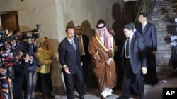 Saudi Arabian Foreign Minister Saud al-Faisal, center, arrives to attend an Arab League's emergency meeting in Cairo, March 12, 2011