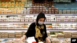 A woman shops in a supermarket in north Tehran, Iran, Sept. 25, 2021.