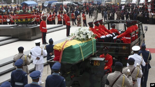 The coffin of the late Ghanaian President John Atta Mills is transported in Accra, Ghana, August 10, 2012.