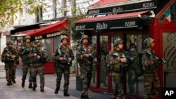 Soldiers in St. Denis, a northern suburb of Paris, Nov. 18, 2015.