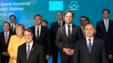 FILE - European Union and Western Balkans leaders stand during a group photo at the EU-Western Balkans summit, at the Brdo Congress Center in Kranj, Slovenia, Oct. 6, 2021.