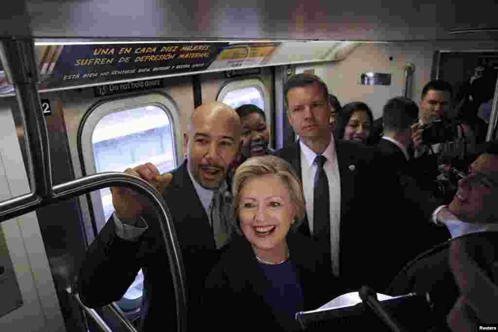 U.S. Democratic presidential candidate Hillary Clinton (C) rides the New York City Subway with Bronx Borough President Ruben Diaz (L).