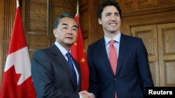 Canada's Prime Minister Justin Trudeau (R) meets with China's Foreign Minister Wang Yi during in Trudeau's office on Parliament Hill in Ottawa, Ontario, Canada, June 1, 2016.