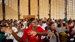 Christians sing during the service at the Our Lady of Consolation Church, which was attacked with grenades by militants almost three years ago, in Garissa, Kenya, April 5, 2015.
