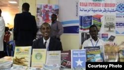 Participants are seen behind a display at the Mogadishu Book Fair in Mogadishu, Somalia. (Courtesy - Mogadishu Book Fair)