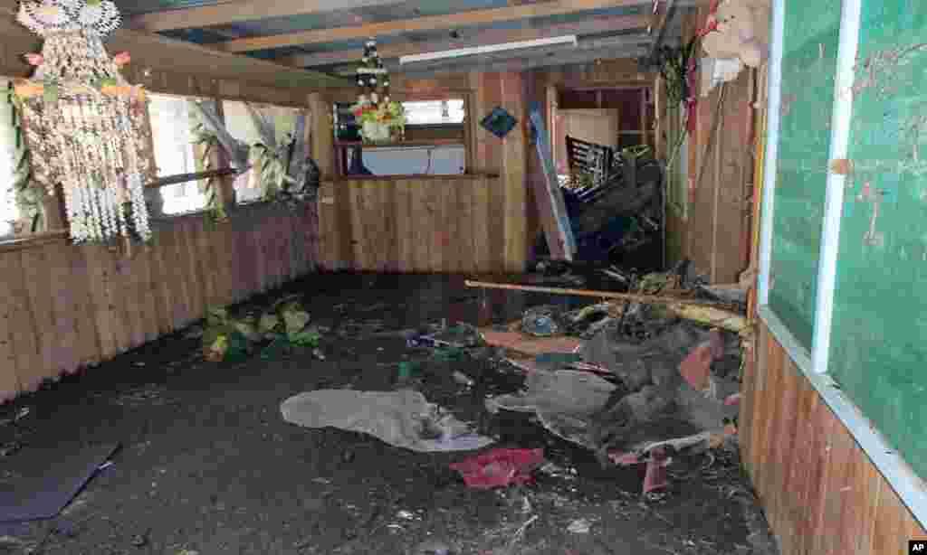 A badly damaged home is seen following a tsunami, Lata, Temotu province, Solomon Islands, Feb. 6, 2013. (World Vision)