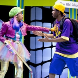 "The Graffiti Fairy (Paige Hernandez) confronts P. Nokio (Psalmayene 24) in a scene from Imagination Stage's hip hop retelling of ""Pinocchio."""