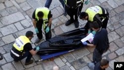 FILE - Israeli emergency services remove the body of an alleged Palestinian attacker in Jerusalem Friday, Feb. 19, 2016. The Palestinian stabbed two officers before he was shot and killed, police said.