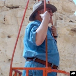 Egyptian archeologist Zahi Hawass prepares to enter a shaft some believe may lead to Cleopatra's tomb, 08 May 2010