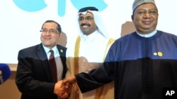 FILE -- Algerian Energy Minister Noureddine Boutarfa, left, Bin Saleh Al-Sada, Minister of Energy and Industry of Qatar, center, and acting Secretary General of OPEC Mohammed Barkindo, right, shake hands at the end of a meeting of oil ministers of the Organization of Petroleum Exporting Countries in Algiers, Algeria, September 28, 2016.