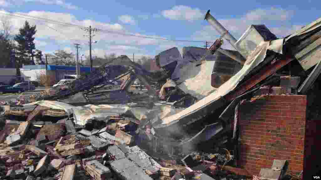 This beauty supply store was completely destroyed as a result of the violence that followed the grand jury annoucement in Ferguson, Missouri, Nov. 25, 2014. (Kane Farabaugh/VOA)