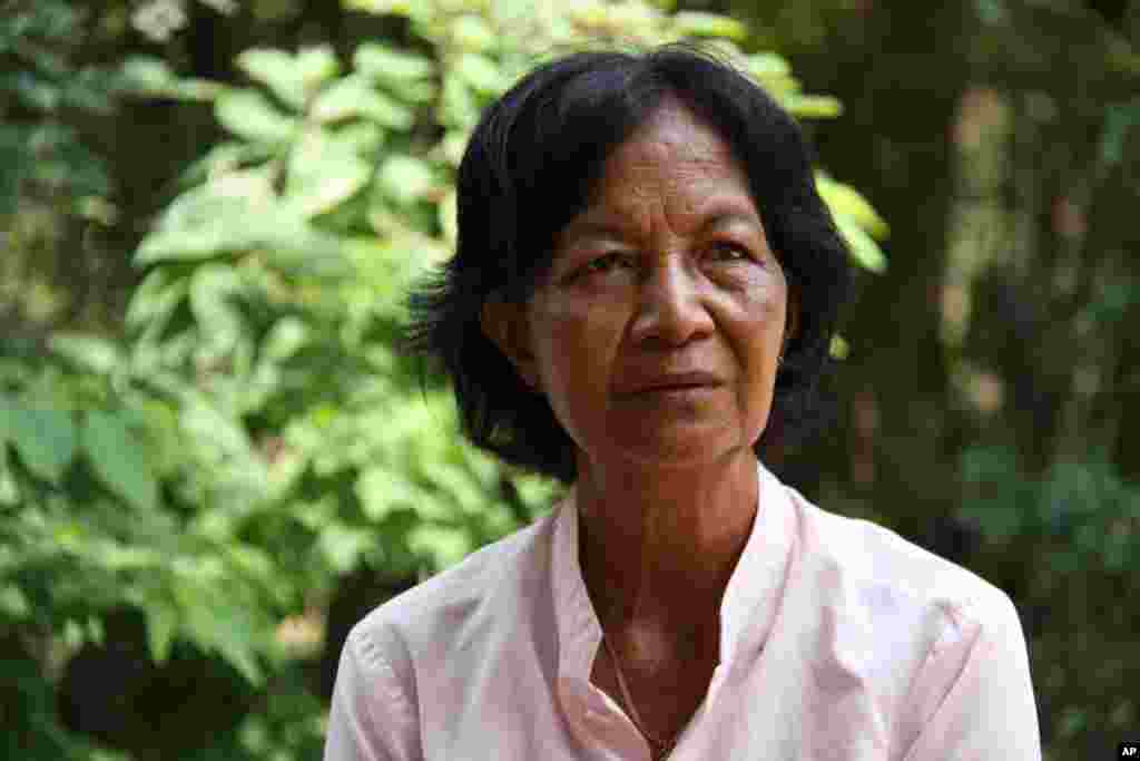 Pol Yam says her cousin is lying about his role in the disappearance of their family members, Kraing Leav village, Cambodia, June 26, 2011.