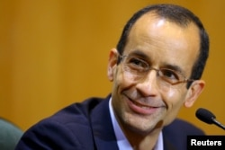 FILE - Marcelo Odebrecht, then the head of Latin America's largest engineering and construction company Odebrecht SA, smiles as he gives his testimony in a session of the Parliamentary Committee of Inquiry in Curitiba, Brazil, Sept. 1, 2015.