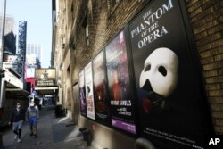 FILE - Broadway posters outside the Richard Rodgers Theatre in New York on May 13, 2020. (Photo by Evan Agostini/Invision/AP, File)