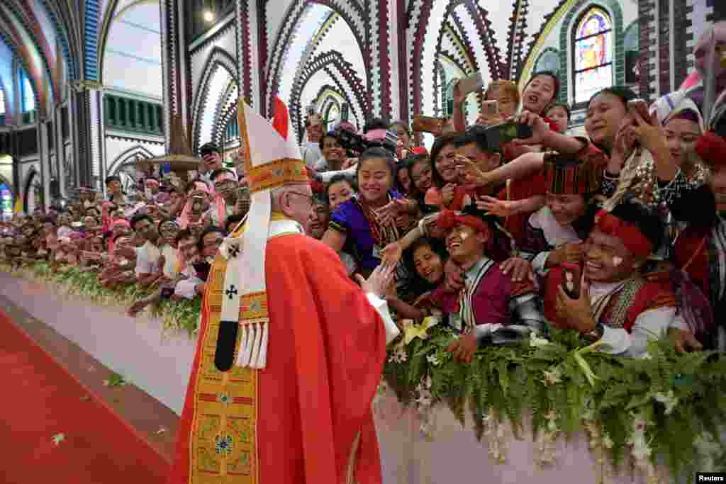 Pope Francis blesses faithful during a Mass at St Mary's Cathedral in Yangon