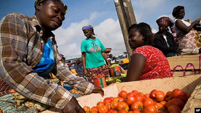A vendor sorts tomatoes at the Agbogboloshie food market in Accra, Ghana.