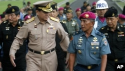 Chief of Thai Defense Force Gen. Thanasak Patimaprakorn, left, walks with Indonesian Marine Chief of Staff Brig. Gen Achmad Faridz during his visit at the marine headquarters in Jakarta, Indonesia, July 18, 2012.