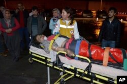 Medics carry a wounded student to an ambulance in Aladag, Adana, in southern Turkey, Nov. 29, 2016. A fire at a middle school dormitory for girls in southern Turkey left at least 12 people dead.