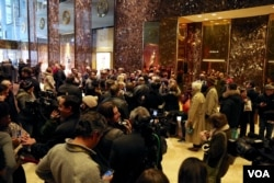 Trump campaign manager Kellyanne Conway, quite a celebrity at Trump Tower, agrees to selfie after selfie with tourists in the building's lobby in New York, Dec. 12, 2016. (R. Taylor/VOA)