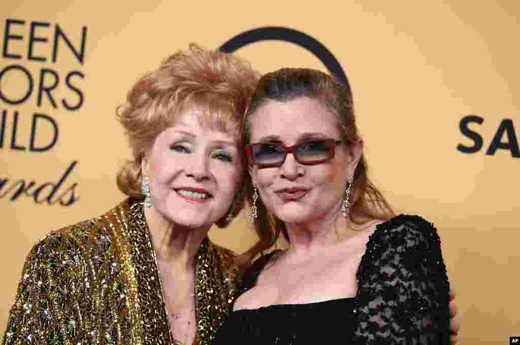 U.S. film actress Debbie Reynolds, 84, (left), died, Dec. 28, 2016, after suffering a stroke, one day after her film star daughter, Carrie Fisher, (right) died of a heart attack.