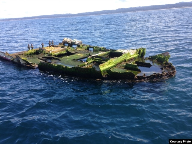 This is the Japanese boat wreckage that was recovered off of Newport, Oregon, last April with a school of non-native fish inside its hull. (Photo courtesy of John Chapman, OSU-HMSC)