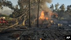 Wildfires are causing damage and threatening property in California and Washington.