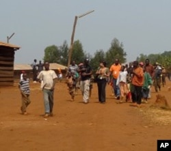 Refugees walk down the main street in the Gasorwe Refugee Camp in northern Burundi.