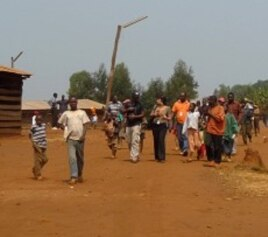 Refugees walk down the main street in the Gasorwe Refugee Camp in northern Burundi.