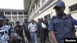 Laurent Akoun, center, a top FPI official, after his trial at a court in Abidjan, August 31, 2012.