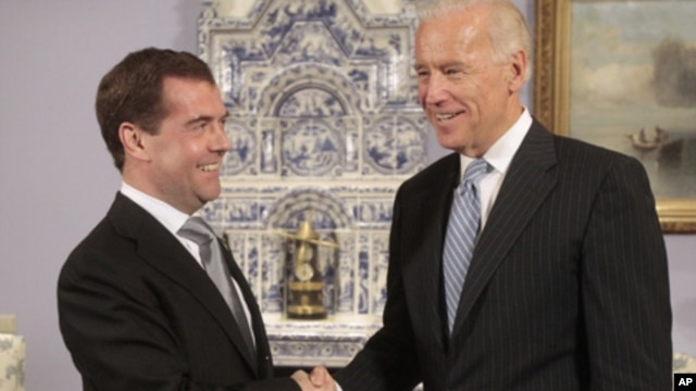 U.S. Vice President Joe Biden (R) shakes hands with Russia's President Dmitry Medvedev during their meeting in the presidential residence at Gorki, outside Moscow March 9, 2011.