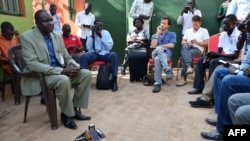 "Oliver Modi, left, of the Union of Journalists of South Sudan attends a meeting in Juba on the killing of Peter Moi of The New Nation newspaper, Aug. 21, 2015. Days earlier, President Salva Kiir threatened to kill journalists who reported ""against the country."""