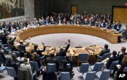 FILE - In this photo provided by the United Nations, members of the United Nations Security council vote at the United Nations headquarters on Friday, Dec. 23, 2016, in favor of condemning Israel for its practice of establishing settlements in the West Bank.