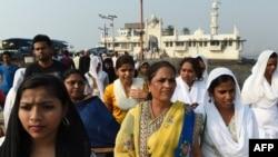 Indian women leave after visiting the inner sanctum of the Haji Ali Dargah in Mumbai, Nov. 29, 2016.