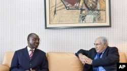 International Monetary Fund Managing Director Dominique Strauss-Kahn (R) meets with Philippe Henri Dacoury-Tabley, governor of the BCEAO, the West African central bank, in Abidjan (File Photo).