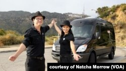 Natcha Morrow (left), a Thai co-owner of sightseeing tour company in Los Angeles stands in front of tour van with her American husband Mark Morrow