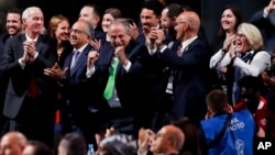 Delegates of Canada, Mexico and the United States celebrate after winning a joint bid to host the 2026 World Cup at the FIFA congress in Moscow, Russia, June 13, 2018.