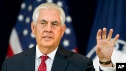 Secretary of State Rex Tillerson gestures while speaking to State Department employees at the State Department in Washington, May 3, 2017.