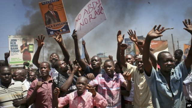 Residents take to the streets to protest the results of the Orange Democratic Movement primary elections the town of Kisumu in western Kenya, January 20, 2013.