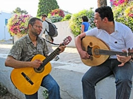 Thabet Graia (R) and Talel Aleli (L), both 32, singing in the Tunis suburb of Sidi Bou Said.