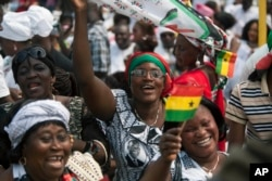 FILE - Supporters cheer during the inauguration ceremony for President John Mahama in Accra, Ghana, Jan. 7, 2013. The election for Ghana's next president will be held December 7.
