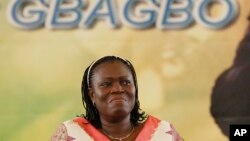 FILE - Simone Gbagbo, wife of Laurent Gbagbo, reacts during a pro-Gbagbo rally in Abidjan, Ivory Coast, Nov. 22, 2012.
