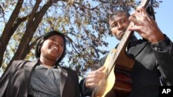 Singer Bertha Matthews and guitarist Sipho Dube make their living playing for money in the streets of Soweto, where a lot of development is bringing tourists into the famous township